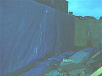 Picture showing the blue canvas covering the missing wall