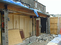 Picture showing the back of the pub with the wall knocked down and the temporary wall inside
